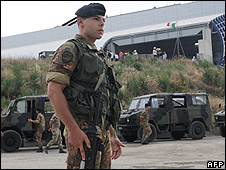 Italian soldier at rubbish dump near Naples, 1 July 08