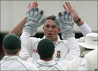 Andre Nel (centre) is congratulated after removing Alastair Cook