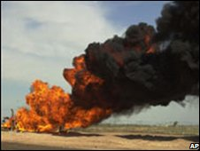 An oil pipeline in Tikrit on fire after an attack (2005)