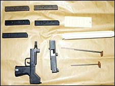 A recovered Mac 10 sub-machine gun and components