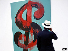 A visitor looking at Andy Warhol painting: Dollar Sign,1981