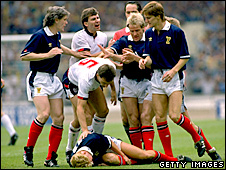 Terry Butcher commiserates with Grant Johnson after an incident at Wembley in 1988