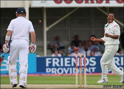 Makhaya Ntini (right) celebrates the wicket of Ian Bell (left)