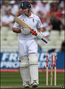 Andrew Strauss trudges off after accidentally treading on his stumps