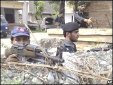 Pakistani police officers take position at a check post in Kabal, a troubled area of Swat valley in northern Pakistan on Wednesday, July 30, 2008
