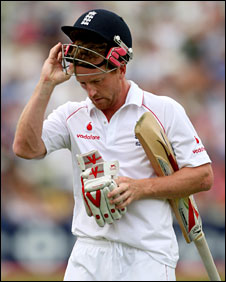 Paul Collingwood takes his helmet off after he is dismissed for four