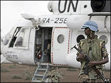 Peacekeeper stands guard next to a UN helicopter in north Darfur (9 July)