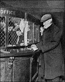 A man collects his first pension from a Post Office in January 1909
