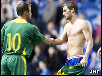 Kevin Thomson shakes hands with a Kaunas player at full-time