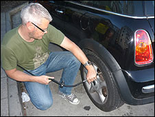Rob checking tyre pressure
