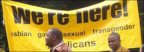 "African Anglican gays celebrating their Christian faith in front of a poster saying, ""We're here"". (Photo: Changing Attitude: www.changingattitude.org.uk)"