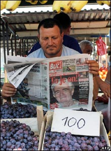 Vendor reads newspaper
