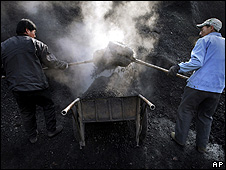 Two miners shovelling coal (Image: AP)