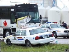Police investigate the scene near Portage La Prairie, Manitoba, Canada