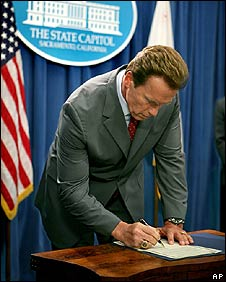 Arnold Schwarzenegger signs his executive order on 31 July