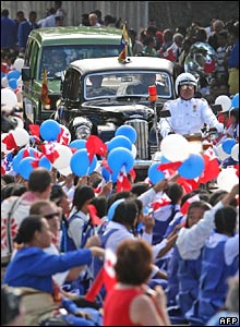 King George Tupou V is driven in a restored black Humber semi-convertible motorcar to his coronation ceremony at the Centenary Free Wesleyan Church in Nuku'alofa on Friday