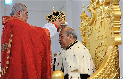 King George Tupou V is crowned by Archbishop of Polynesia Jabez Bryce (L) during his lavish Christian coronation ceremony at the Centenary Free Wesleyan Church in Nuku'alofa on Friday