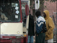 Passengers boarding a bus in Zimbabwe