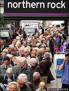 Customers queue to withdraw their savings from Northern Rock's Kingston branch