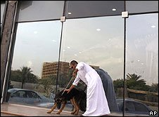 Man walks his dog in Riyadh