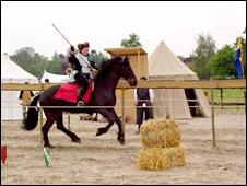 Susan Jones spear a hay target