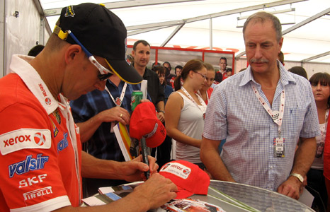 Troy Bayliss signs cap for fan