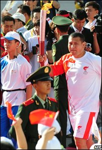 The Olympic torch travels through Urumqi