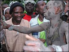 A Luhya initiate undergoes circumcision