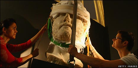 Winching a bust of Hadrian into place