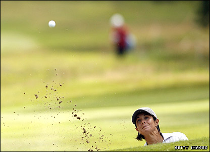 Laura Diaz hits out of a bunker