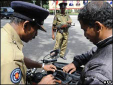 Sri Lankan police check people in Colombo in the run up to the Saarc summit, 30 July 2008