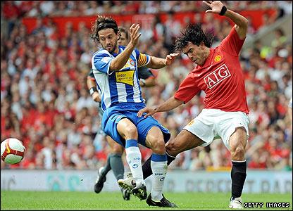 Espanyol's defender Daniel Jarque tangles with Carlos Tevez