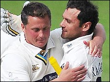 Mark Ramprakash (right) is congratulated by former England team-mate Darren Gough after reaching 100 first-class centuries