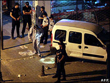 Forensic officers investigate the scene of two bomb explosions in Istanbul, 27 July 2008