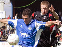 Queens striker Sean O'Connor shields the ball