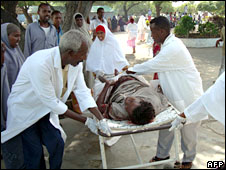 A bomb victim is wheeled towards Mogadishu's main hospital, Somalia, 3 August 2008