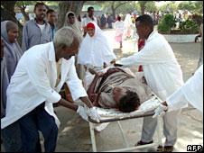 A bomb victim is wheeled towards Mogadishu's main hospital, Somalia, 3 August 2008