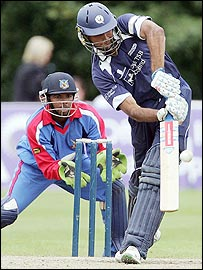 Scotland's Navdeer Poona in action with Bermuda wicketkeeper Jekon Edness