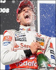 Heikki Kovalainen celebrates his win in Hungary