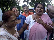 Relatives await news of those caught up in the Nainadevi temple stampede