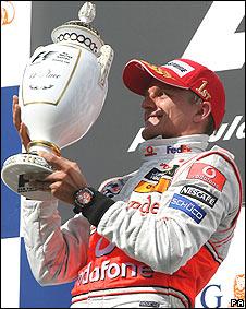 Heikki Kovalainen holds his Hungarian Grand Prix prize