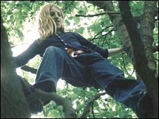 Young girl climbing tree