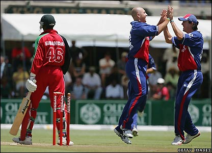Pietersen celebrates a wicket with Alex Wharf