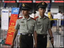 Chinese police patrol the airport in Urumqi, the capital of Xinjiang