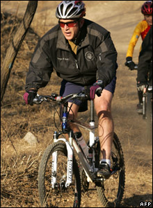 President George W Bush biking
