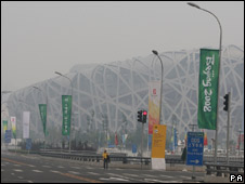 Smog hangs over the Olympic Stadium in Beijing on 4 August 2008