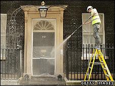 Door of 10 Downing Street being cleaned