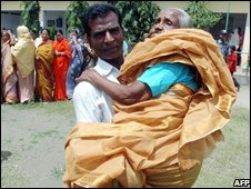 Aman carries his mother after casting her vote at Manikganj