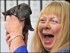 Bernann McKinney with one of the cloned puppies, 5 Aug