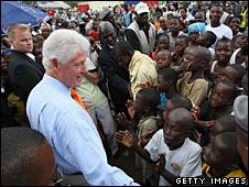 Bill Clinton greets a crowd in Monrovia, Liberia, 3 August 2008